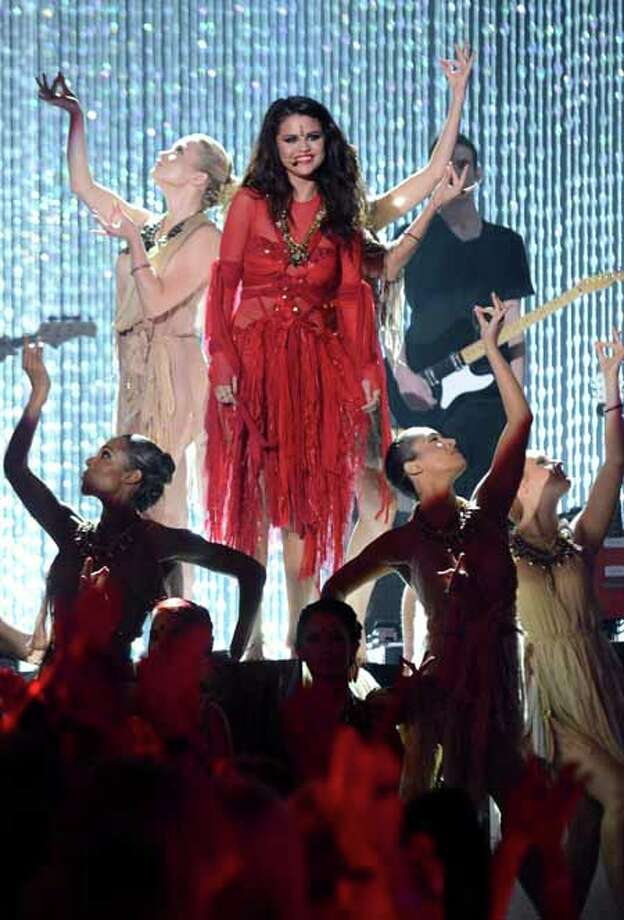 IMAGE DISTRIBUTED FOR MTV - Singer Selena Gomez perform onstage at the MTV Movie Awards in Sony Pictures Studio Lot in Culver City, Calif., on Sunday April 14, 2013. (Photo by Jordan Strauss/Invision for MTV/AP Images) Photo: Jordan Strauss, Associated Press / Invision