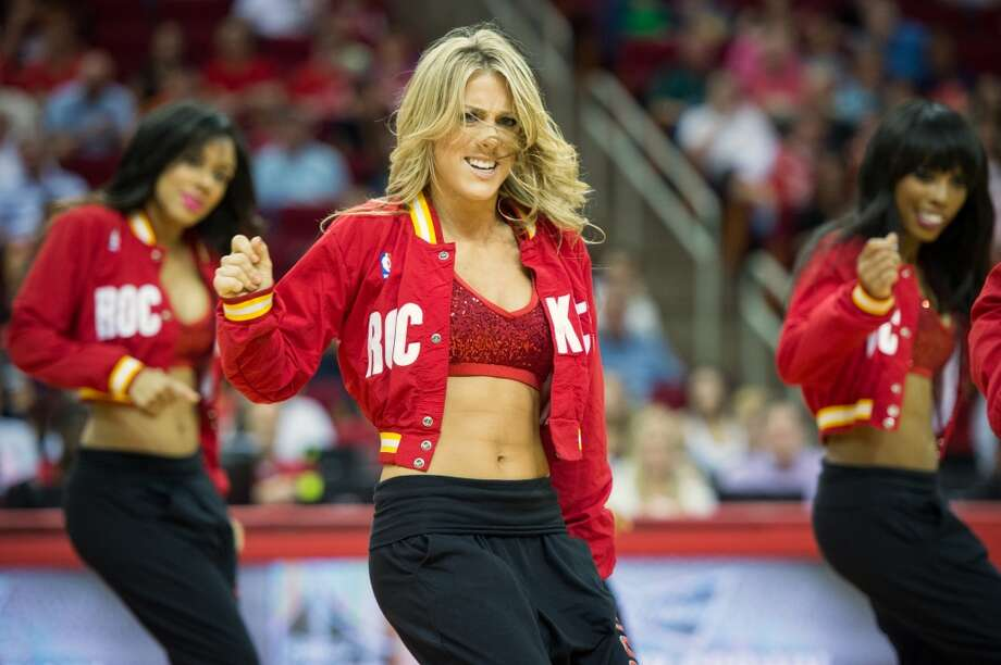 The Houston Rockets Power Dancers perform during an NBA basketball game against the Sacramento Kings at Toyota Center. Photo: Smiley N. Pool, Houston Chronicle