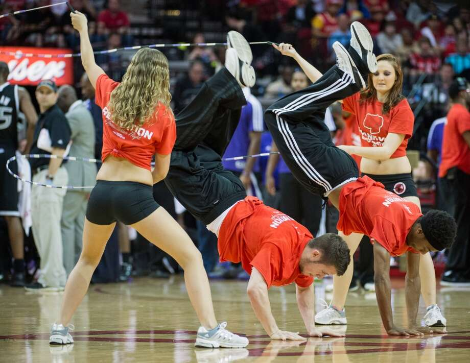 The Houston Rockets Power Dancers perform with the Rockets Launch Crew during an NBA basketball game against the Sacramento Kings at Toyota Center. Photo: Smiley N. Pool, Houston Chronicle