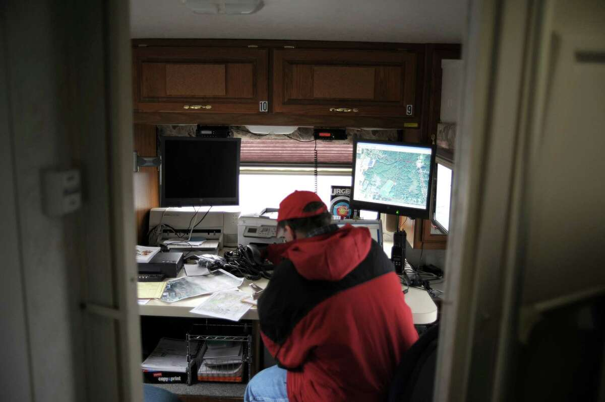 A volunteer works with maps inside the mobile command center of the Northeast Mobile Search & Rescue (NEMSAR) in a parking lot behind the Glenville Price Chopper on Sunday, April 14, 2013 in Glenville, NY. Members of NEMSAR along with members of Tri-State and Team 5-1 search and rescue took part in the search of the wooded area behind the Price Chopper. Over 60 volunteers took part in the search of the 150 acre area, looking for any clues in the disappearance case of Craig Frear, who was seventeen at the time. June 27th will mark the ninth anniversary of the disappearance of Frear. (Paul Buckowski / Times Union)