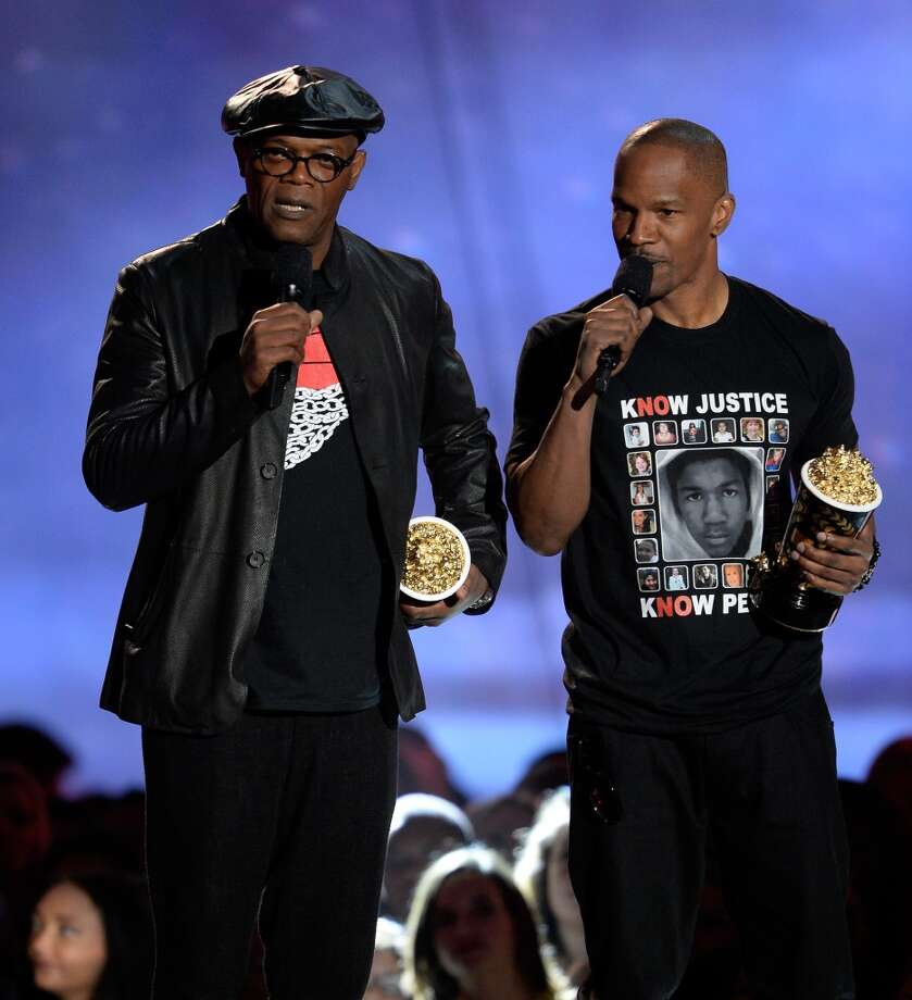 CULVER CITY, CA - APRIL 14:  Actors Samuel L. Jackson (L) and Jamie Foxx accept the WTF Moment award onstage during the 2013 MTV Movie Awards at Sony Pictures Studios on April 14, 2013 in Culver City, California.  (Photo by Kevork Djansezian/Getty Images)