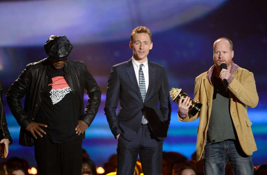 "CULVER CITY, CA - APRIL 14:  (L-R) Actors Chris Evans and Samuel L. Jackson and director Joss Whedon accept the Movie of the Year award for ""Marvel's The Avengers"" onstage during the 2013 MTV Movie Awards at Sony Pictures Studios on April 14, 2013 in Culver City, California.  (Photo by Kevork Djansezian/Getty Images)"