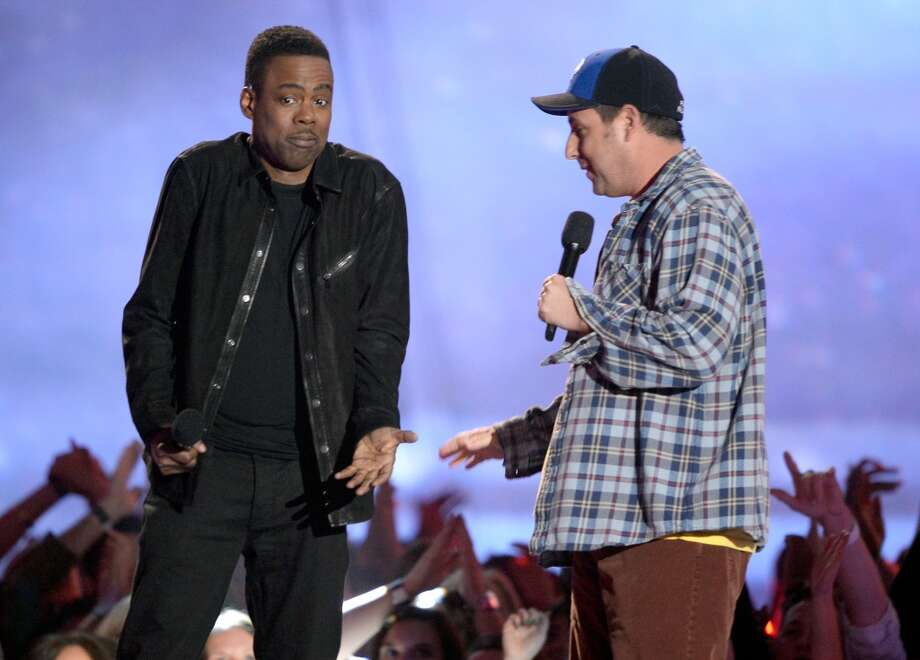 CULVER CITY, CA - APRIL 14:  Actors Chris Rock (L) and Adam Sandler speak onstage during the 2013 MTV Movie Awards at Sony Pictures Studios on April 14, 2013 in Culver City, California.  (Photo by Kevork Djansezian/Getty Images)