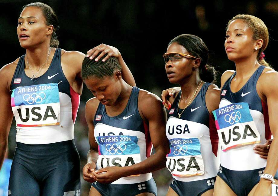 The Olympian (on the left) went from on top of the world to buried under a pile of debt. Jones owed millions after being sentenced for perjury in her steroid scandal and served jail time for check fraud. Photo: MARK BAKER, AP / AP