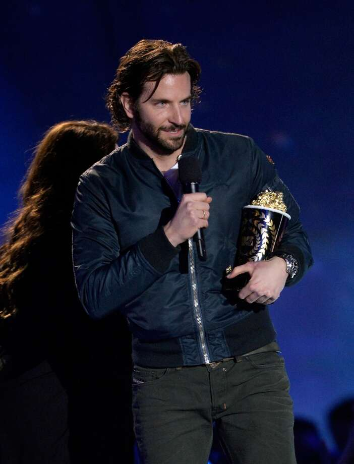 "CULVER CITY, CA - APRIL 14:  Actor Bradley Cooper accepts Best Male Performance award for ""Silver Linings Playbook"" onstage during the 2013 MTV Movie Awards at Sony Pictures Studios on April 14, 2013 in Culver City, California.  (Photo by Kevork Djansezian/Getty Images)"