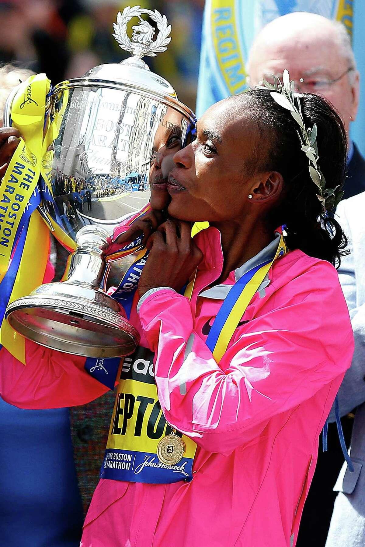 BOSTON, MA - APRIL 15: Rita Jeptoo of Kenya kisses the trophy after winning the women?s division of the 117th Boston Marathon on April 15, 2013 in Boston, Massachusetts.