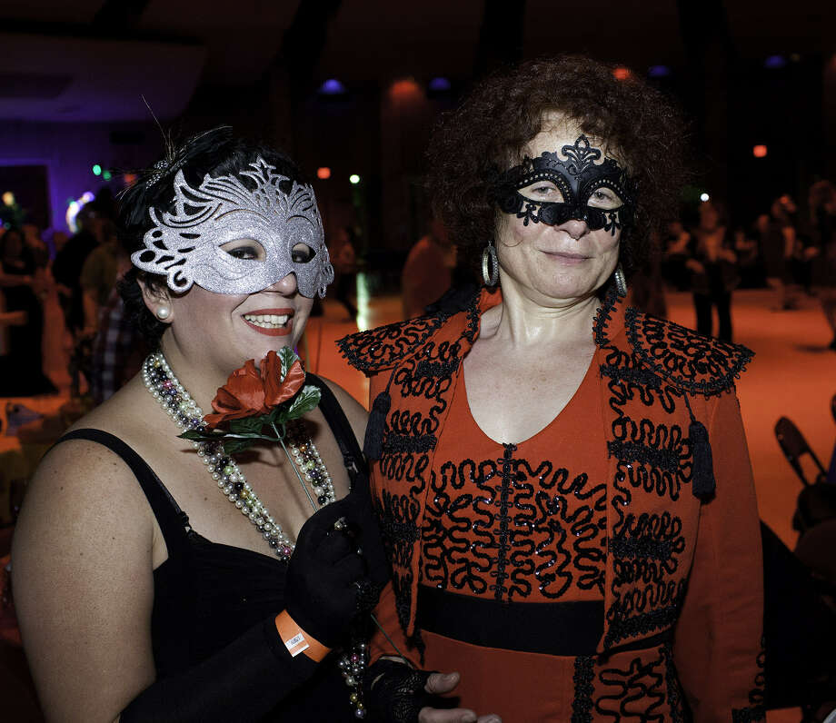 From the left, Paula Rodriguez and Isabelle Burke at Incognito, Fiesta's masked ball, set for Friday at the La Villita Assembly Hall. Photo: San Antonio Express-News File Photo