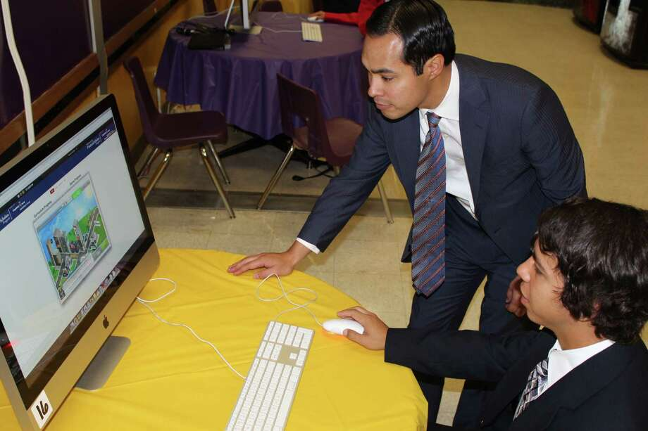 A Brackenridge High School student demonstrates for Mayor Julián Castro how the highly interactive Capital One Financial Scholars Program works during an event April 9. Photo: Courtesy Photo