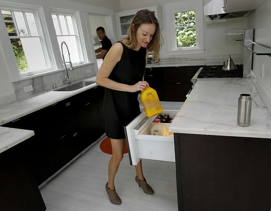 Bea Johnson shows off her tiny refrigerator Sunday April 7, 2013. Bea Johnson, who writes the popular ZeroWaste blog and is the author of ZeroWaste Home manages to generate less than a quart of garbage a year in her Mill Valley, Calif home. Photo: Brant Ward, The Chronicle