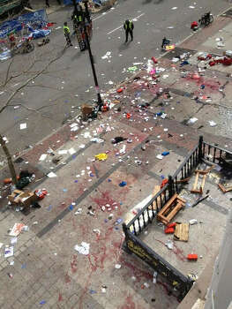 This photo provided by Bruce Mendelsohn shows the scene after two  explosions occurred during the 2013 Boston Marathon in Boston, Monday,  April 15, 2013. Two explosions shattered the euphoria of the Boston  Marathon finish line on Monday, sending authorities out on the course to  carry off the injured while the stragglers were rerouted away from the  smoking site of the blasts. Photo: Bruce Mendelsohn, AP