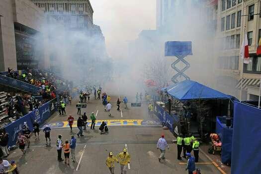Two explosions went off near the finish line of the 117th Boston Marathon on April 15, 2013. Photo: Boston Globe / 2013 - The Boston Globe