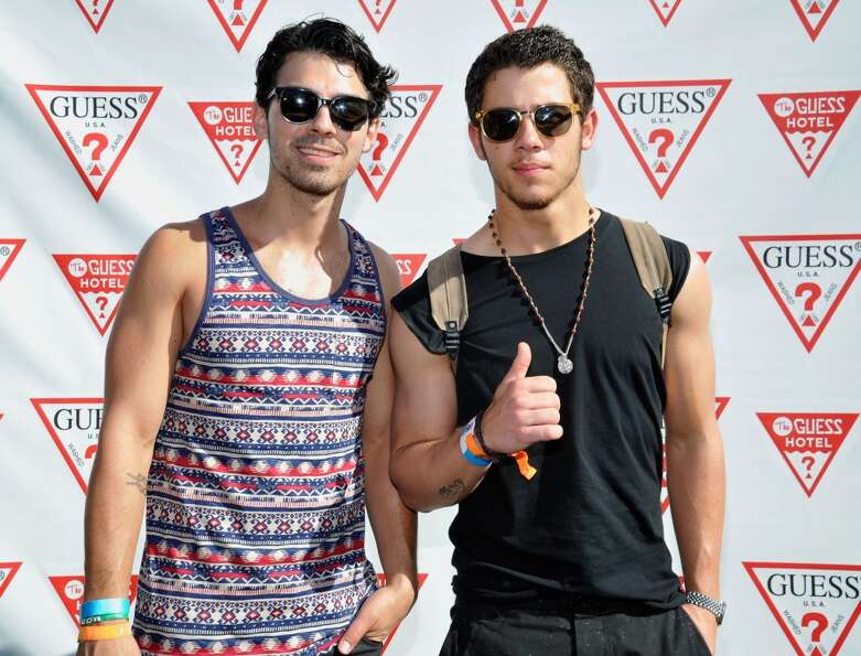 PALM SPRINGS, CA - APRIL 14: Joe Jonas and Nick Jonas attend the GUESS Hotel pool party at the Vicer