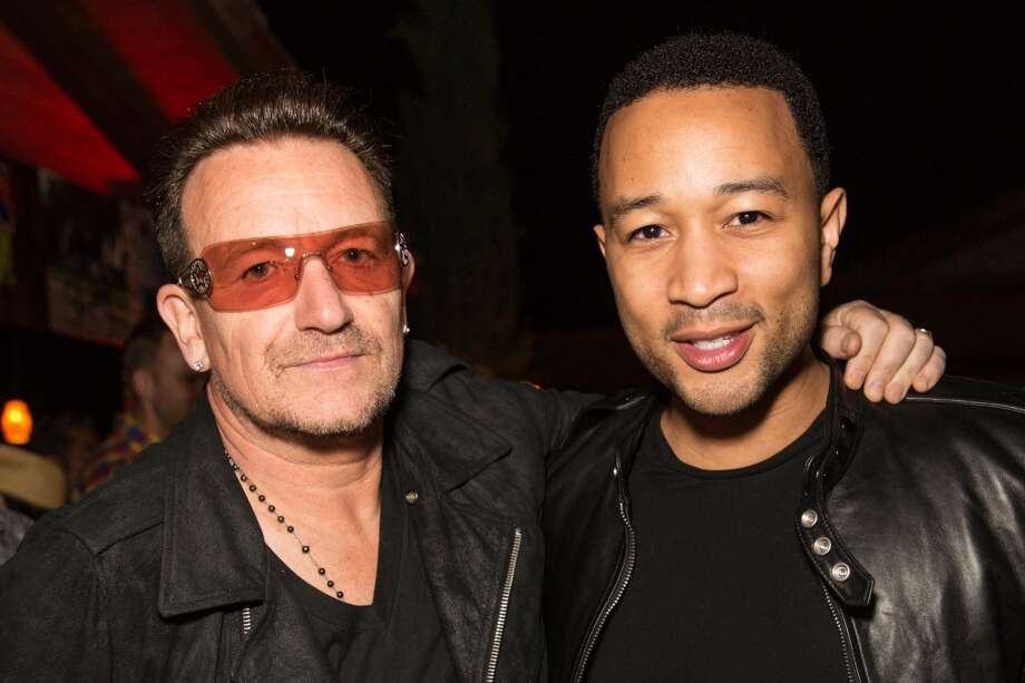 LA QUINTA, CA - APRIL 12:  Singers Bono (L) and John Legend attend the DIESEL + EDUN Studio Africa Event At Indio Valley With Rolling Stone Rock Room at Tally Horse Ranch on April 12, 2013 in La Quinta, California.  (Photo by Chelsea Lauren/Getty Images for DIESEL)