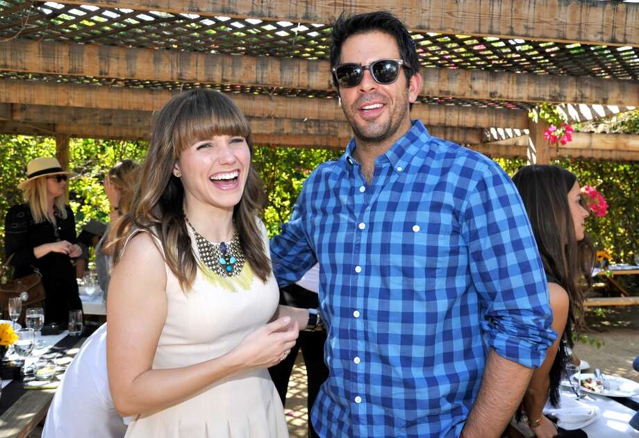PALM SPRINGS, CA - APRIL 12:  Actress Sophia Bush (L) and Actor/filmmaker Eli Roth attend Harper's BAZAAR Coachella poolside fete at the Parker Palm Springs on April 12, 2013 in Palm Springs, California.  (Photo by John Sciulli/Getty Images for Harper's BAZAAR)