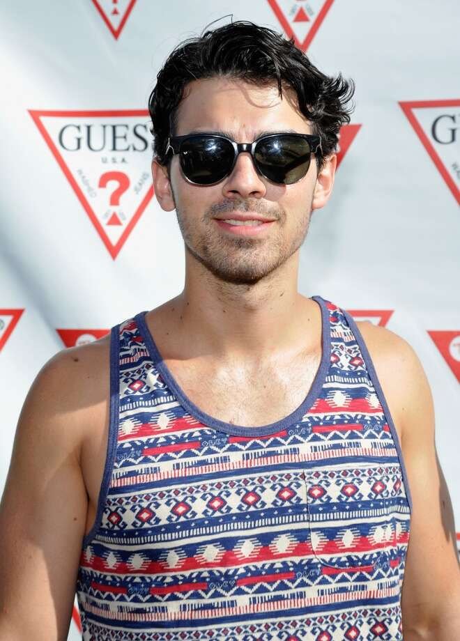 PALM SPRINGS, CA - APRIL 14:  Joe Jonas attends the GUESS Hotel pool party at the Viceroy Palm Springs on April 14, 2013 in Palm Springs, California.  (Photo by John Sciulli/Getty Images for GUESS)