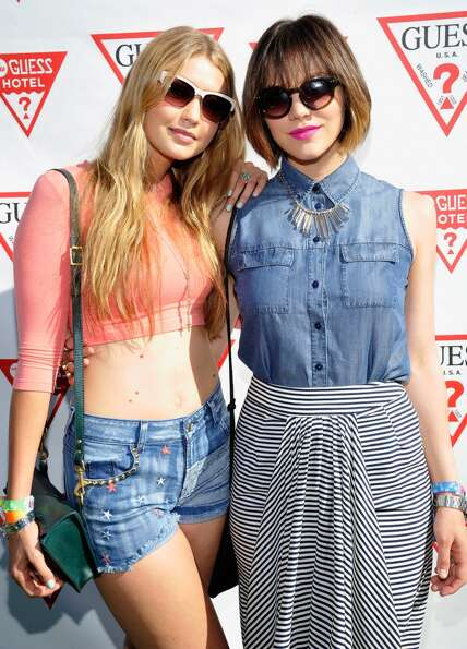 PALM SPRINGS, CA - APRIL 14:  Gigi Hadid and Kat McPhee attend the GUESS Hotel pool party at the Vic