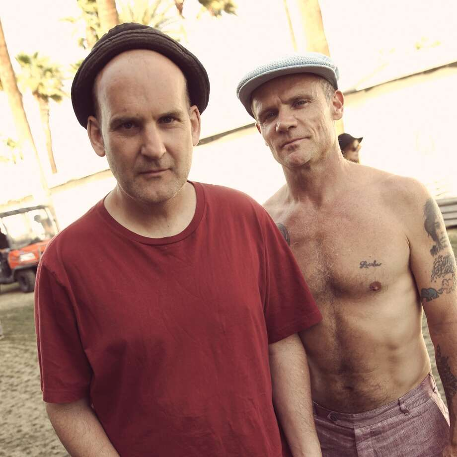 INDIO, CA - APRIL 14:   (EDITORS NOTE: THIS IMAGE HAS BEEN DIGITALLY MANIPULATED) Musicians Ian MacKaye and Flea backstage during day 3 of the 2013 Coachella Valley Music & Arts Festival at the Empire Polo Club on April 14, 2013 in Indio, California.  (Photo by Karl Walter/Getty Images for Coachella)