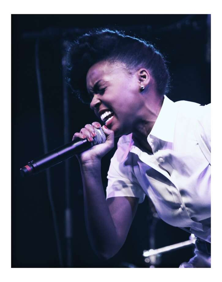 INDIO, CA - APRIL 13:  (EDITORS NOTE:  THIS IMAGE HAS BEEN DIGITALLY MANIPULATED) Singer Janelle Monae performs onstage during day 1 of the 2013 Coachella Valley Music & Arts Festival at the Empire Polo Club on April 13, 2013 in Indio, California.  (Photo by Trixie Textor/Getty Images)