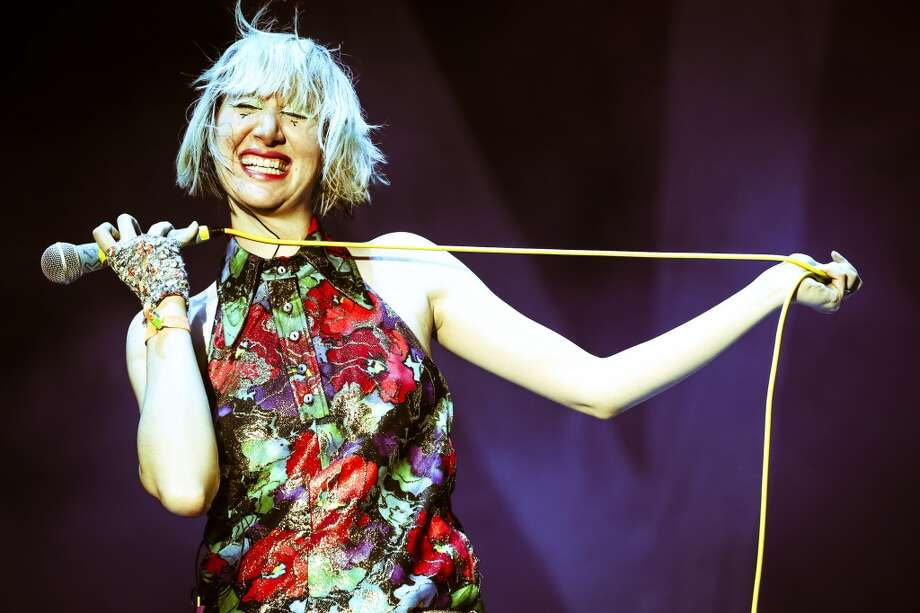 INDIO, CA - APRIL 12:   (EDITORS NOTE: THIS IMAGE HAS BEEN DIGITALLY MANIPULATED) Singer Karen O of the Yeah Yeah Yeahs performs onstage during day 1 of the 2013 Coachella Valley Music & Arts Festival at the Empire Polo Club on April 12, 2013 in Indio, California.  (Photo by Karl Walter/Getty Images for Coachella)