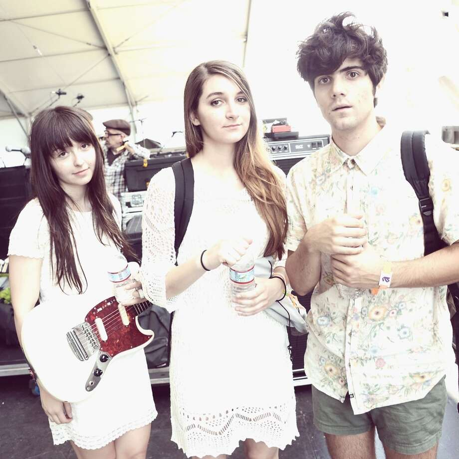 INDIO, CA - APRIL 12:  (EDITORS NOTE: THIS IMAGE HAS BEEN DIGITALLY MANIPULATED) Musicians Carlee Hendrix, Alyssa Midcalf and Ignacio Caniza of You Me & Us pose backstage during day 1 of the 2013 Coachella Valley Music & Arts Festival at the Empire Polo Club on April 12, 2013 in Indio, California.  (Photo by Jason Kempin/Getty Images for Coachella)