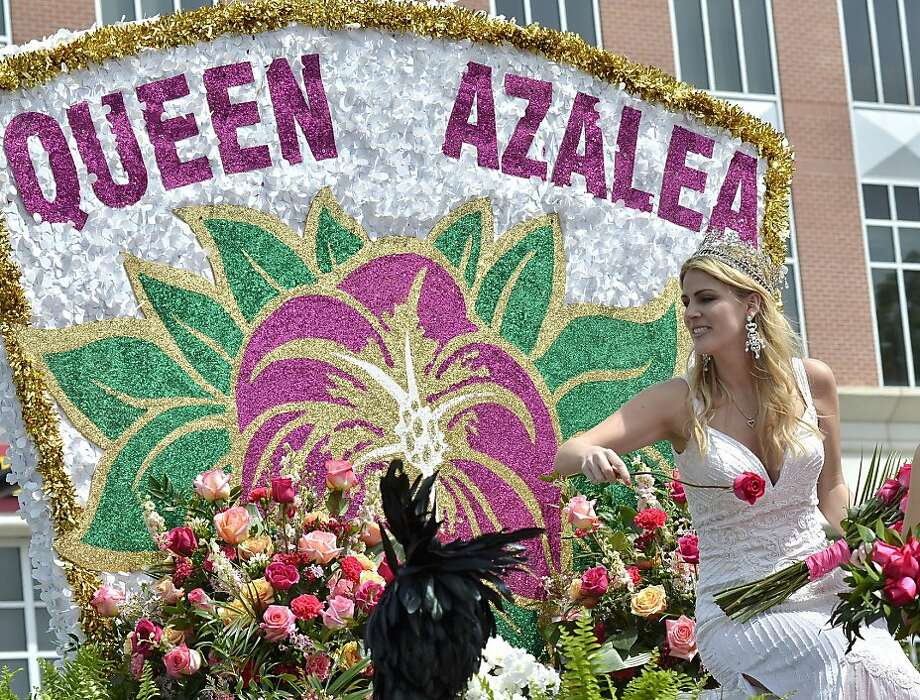 Roses? Where are the azaleas?! Queen Azalea Jennifer Wayne tosses roses to the crowd at the Azalea Festival in downtown Wilmington, N.C. Photo: Laura Greene, Associated Press