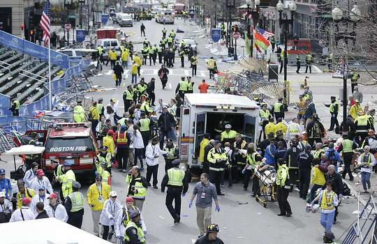 Medical workers aid injured people at the finish line of the 2013 Boston Marathon following an explosion in Boston, Monday, April 15, 2013. (AP Photo/Charles Krupa) Photo: Charles Krupa, Associated Press