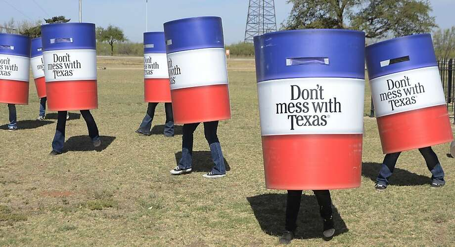 Cheerleaders become drum majorettes:Odessa College cheer team members don trash cans and dance to promote a state litter cleanup at the Petroleum Museum in Midland, Texas. Photo: Mark Sterkel|, Associated Press