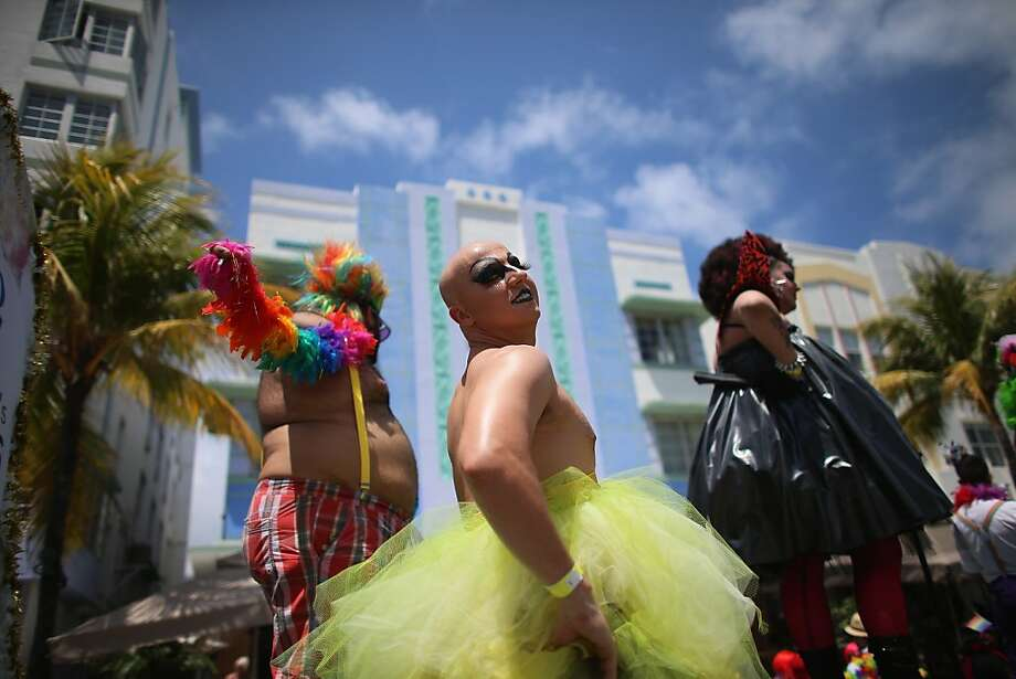 Who was that mascara'ed man?Revelers get ready to march in the Miami Beach Gay Pride Parade, which drew tens of thousands to Ocean Drive. Photo: Joe Raedle, Getty Images