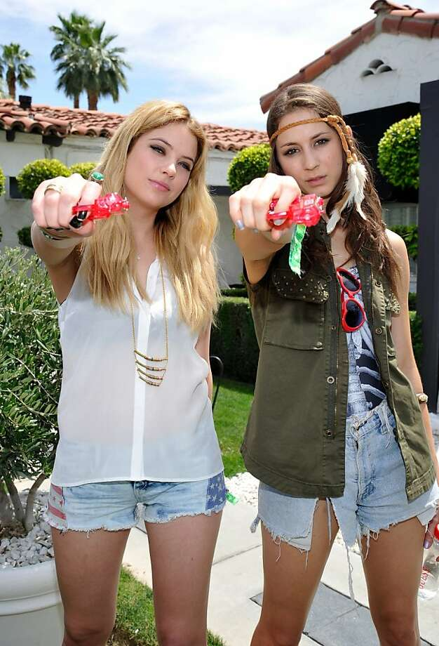 "Soap and water:Actresses Ashley Benson (""Days of Our Lives"") and Troian Bellisario (""Pretty Little Liars"") aren't celebrating the Songkran water festival at the GUESS Hotel pool party in Palm Springs, Calif. They just like shooting people with water pistols. Photo: John Sciulli, Getty Images For GUESS"