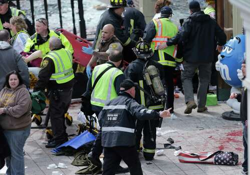 Medical workers aid injured people at the finish line of the 2013 Boston Marathon following an explosion in Boston, Monday, April 15, 2013. (AP Photo/Charles Krupa) Photo: Associated Press