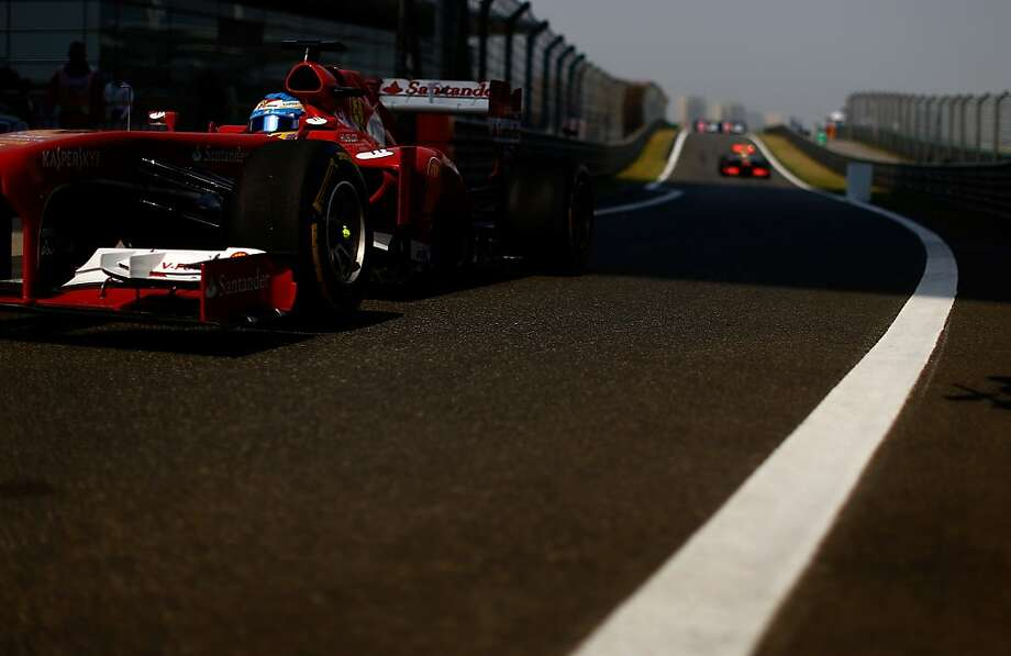 Formula for success:Spaniard Fernando Alonso of Ferrari drives into the pit lane before the beginning of the Chinese Formula One Grand Prix at the Shanghai International Circuit. He went on to win the race. Photo: Vladimir Rys, Getty Images