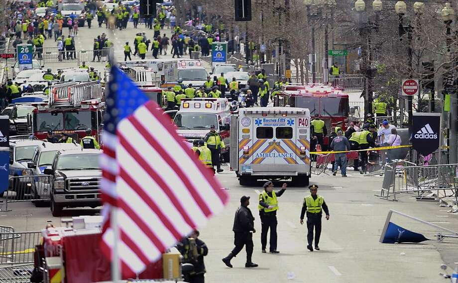 Emergency workers aid injured people at the finish line of the 2013 Boston Marathon following an explosion in Boston, Monday, April 15, 2013. (AP Photo/Charles Krupa) Photo: Charles Krupa, Associated Press