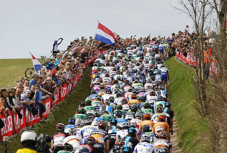 Holland funnel:Crammed together on a narrow road, cyclists rub elbows as they climb a small hill during the Valkenburg bike race in the Netherlands. Photo: Bas Czerwinski, AFP/Getty Images