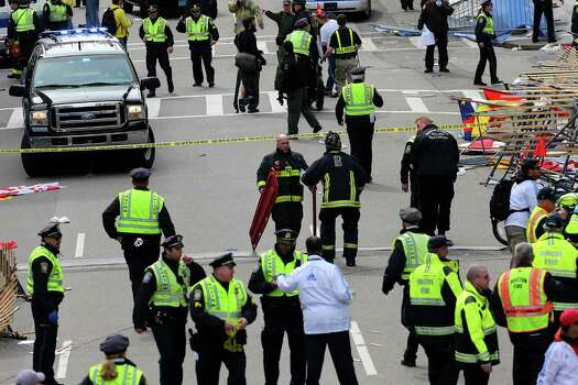 BOSTON - APRIL 15: Emergency personnel respond to the scene after two explosions went off near the finish line of the 117th Boston Marathon on April 15, 2013. Photo: Boston Globe, Getty Images / 2013 - The Boston Globe