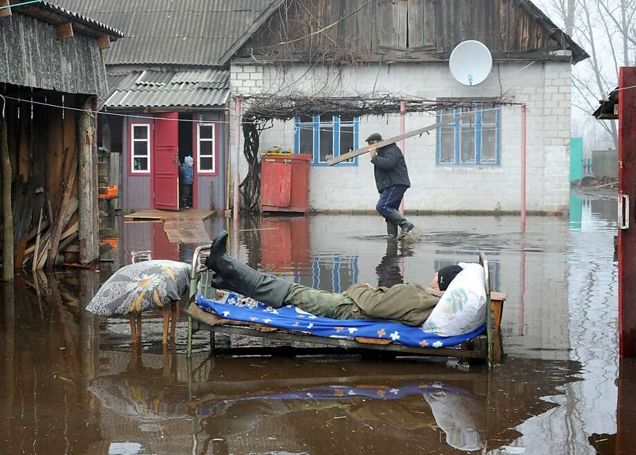 I think I wet the bed:A man catches some shuteye in the flooded Belarus village of Khvoensk. Photo: Viktor Drachev, AFP/Getty Images