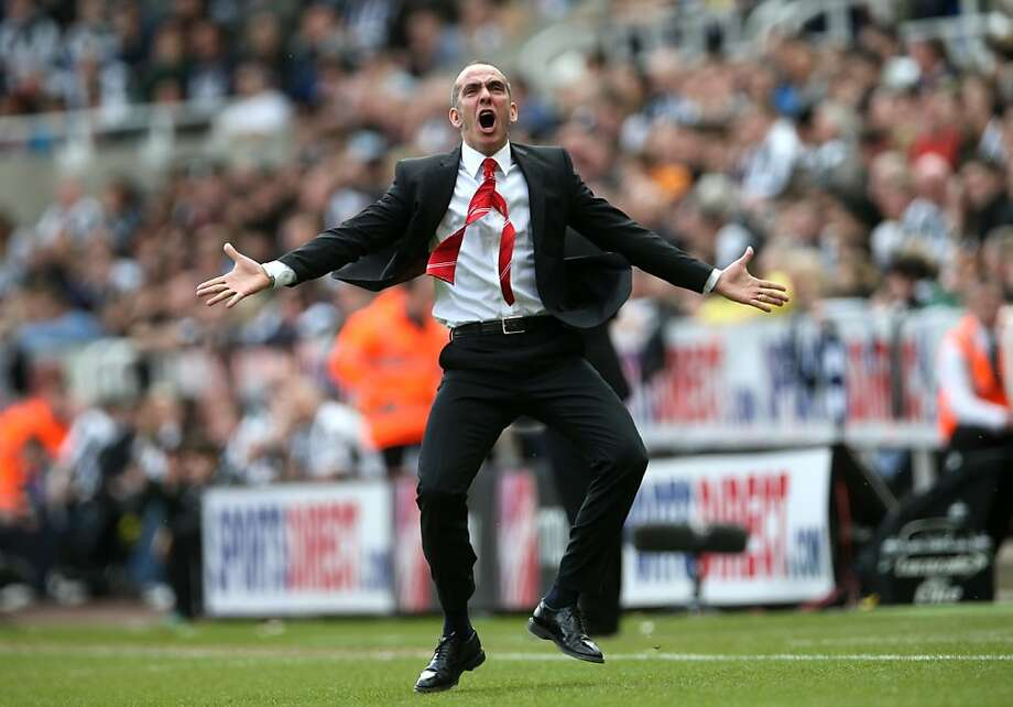 Life is beautiful! Paolo Di Canio, the demonstrative manager of Sunderland, leaps for joy after his team scores a goal in an English Premier League soccer match against Newcastle. Photo: Ian Macnicol, AFP/Getty Images