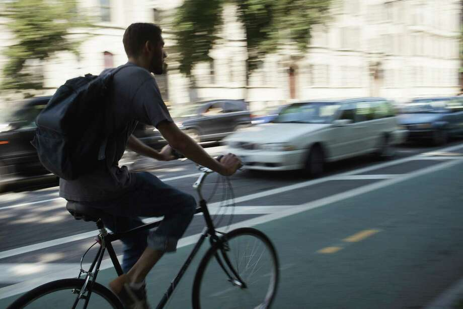Bike Lanes: The New York Times reported that New York has 570 miles of bikes lanes, while Seattle has just 180. Photo: Spencer Platt, Getty Images / 2011 Getty Images