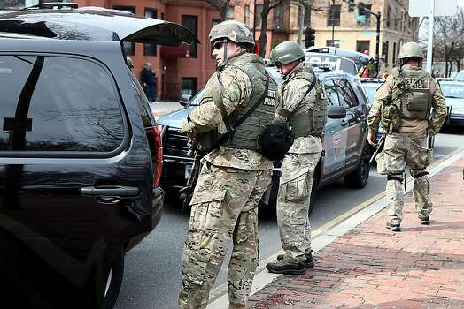 BOSTON, MA - APRIL 15:  State police guard an area near Kenmore Square after two bombs exploded during the 117th Boston Marathon on April 15, 2013 in Boston, Massachusetts. Two people are confirmed dead and at least 23 injured after two explosions went off near the finish line to the marathon.  (Photo by Alex Trautwig/Getty Images) Photo: Alex Trautwig, Getty Images
