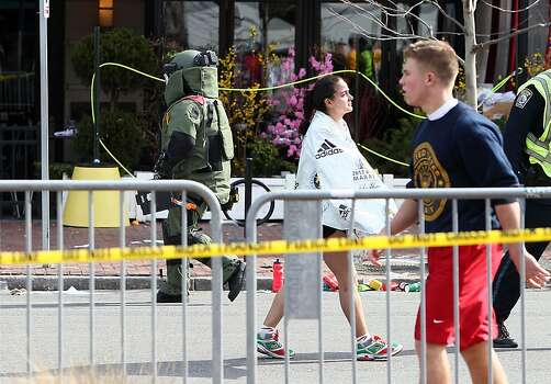 BOSTON, MA - APRIL 15:  A member of the bomb squad investigates a suspicious item on the road near Kenmore Square after two bombs exploded during the 117th Boston Marathon on April 15, 2013 in Boston, Massachusetts. Two people are confirmed dead and at least 23 injured after two explosions went off near the finish line to the marathon.  (Photo by Alex Trautwig/Getty Images) Photo: Alex Trautwig, Getty Images