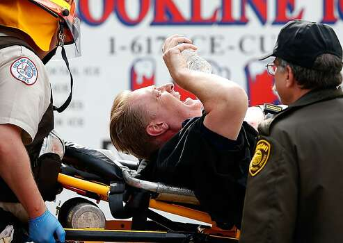 BOSTON, MA - APRIL 15:  A man is loaded into an ambulance after he was injured by one of two bombs exploded during the 117th Boston Marathon near Copley Square on April 15, 2013 in Boston, Massachusetts. Two people are confirmed dead and at least 23 injured after two explosions went off near the finish line to the marathon.  (Photo by Jim Rogash/Getty Images) Photo: Jim Rogash, Getty Images