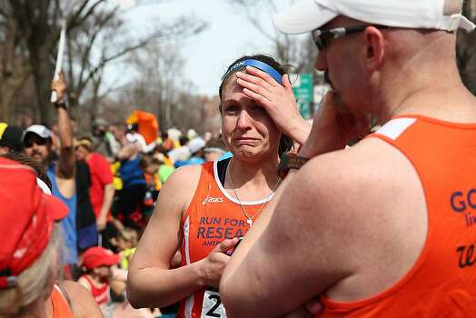 BOSTON, MA - APRIL 15:  A runner reacts near Kenmore Square after two bombs exploded during the 117th Boston Marathon on April 15, 2013 in Boston, Massachusetts. Two people are confirmed dead and at least 23 injured after two explosions went off near the finish line to the marathon.  (Photo by Alex Trautwig/Getty Images) Photo: Alex Trautwig, Getty Images