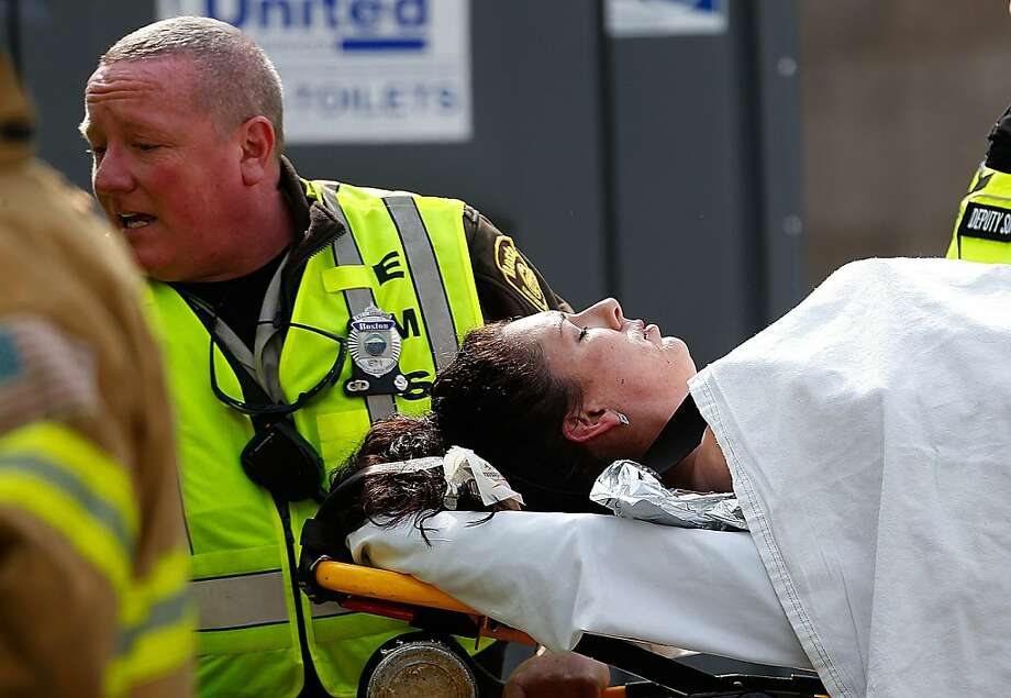 BOSTON, MA - APRIL 15:  A woman is loaded into an ambulance after he was injured by one of two bombs exploded during the 117th Boston Marathon near Copley Square on April 15, 2013 in Boston, Massachusetts. Two people are confirmed dead and at least 23 injured after two explosions went off near the finish line to the marathon.  (Photo by Jim Rogash/Getty Images) Photo: Jim Rogash, Getty Images