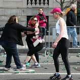 BOSTON, MA - APRIL 15:  A runner embraces another woman near Kenmore Square after two bombs exploded during the 117th Boston Marathon on April 15, 2013 in Boston, Massachusetts. Two people are confirmed dead and at least 23 injured after two explosions went off near the finish line to the marathon.  (Photo by Alex Trautwig/Getty Images)