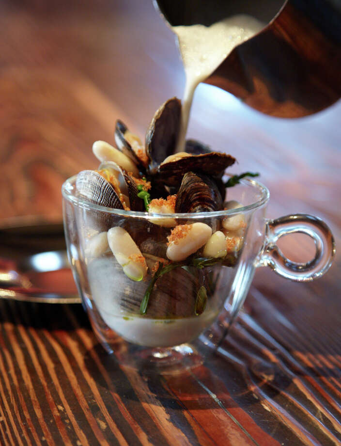 Savory clams with albariño, white beans, chorizo, and herbal broth $11
