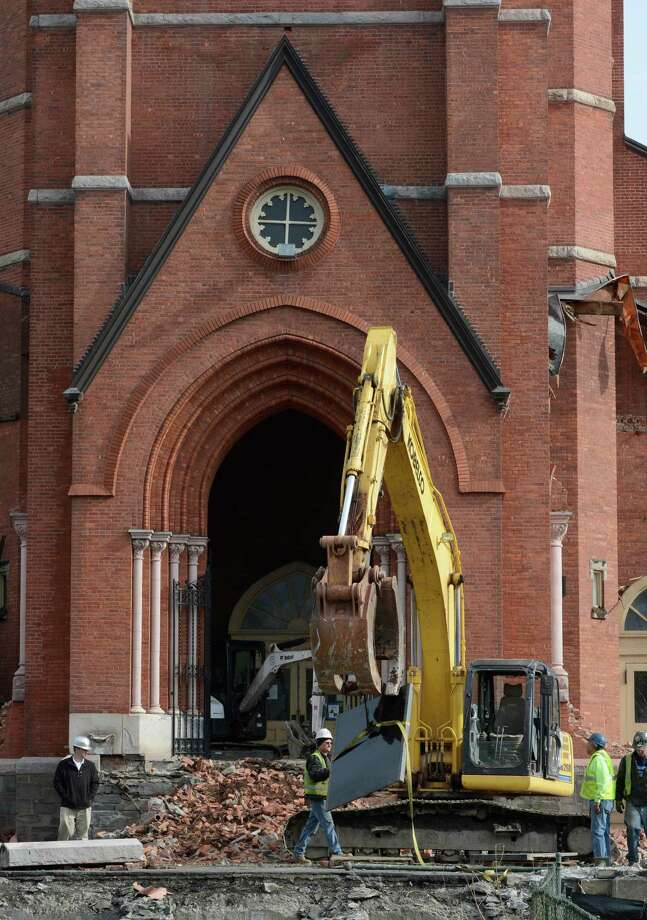 Demolition work continues at St. Patrick's Church Monday morning April 15, 2013 in Watervliet, N.Y.  The workers were removing commemorative plaques from the vestibule of the church.   (Skip Dickstein/Times Union) Photo: SKIP DICKSTEIN / 10021967A