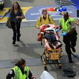 BOSTON - APRIL 15: A person who was injured in an explosion near the finish line of the 117th Boston Marathon is taken away from the scene on a stretcher. (Photo by David L. Ryan/The Boston Globe via Getty Images)