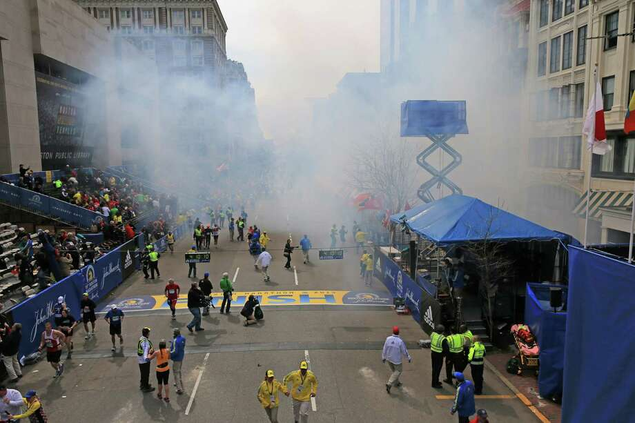 Two explosions went off near the finish line of the 117th Boston Marathon on April 15, 2013. Photo: Boston Globe / 2013 - The Boston Globe