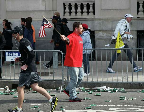 BOSTON, MA - APRIL 15:  People walk near Kenmore Square after two bombs exploded during the 117th Boston Marathon on April 15, 2013 in Boston, Massachusetts. Two people are confirmed dead and at least 23 injured after two explosions went off near the finish line to the marathon. Photo: Alex Trautwig, Getty Images / 2013 Getty Images