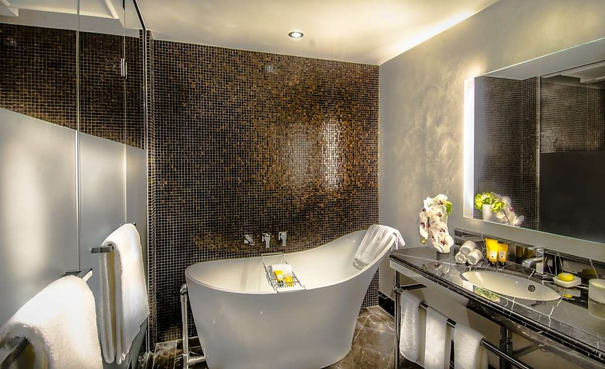 Soaking tubs and rainfall showers are standard at the new 49-room Capella Washington, D.C, Georgetown, a luxury inn on the C&O Canal.