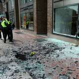 BOSTON - APRIL 15: Boston Police look at blown out windows at the scene of the first explosion on Boylston Street near the finish line of the Boston Marathon.
